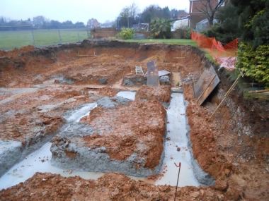 concrete foundations poured and level ready for the bricklayers