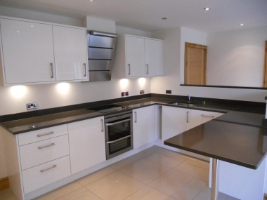 porcelain floor tiles against white gloss kitchen units and quartz worktops chrome taps aeg appliances